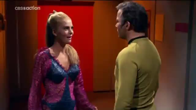 Captain Kirk questions a uninvited guest on his ship